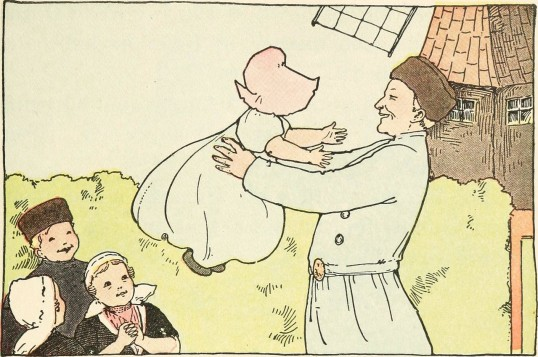 An illustration. A smiling woman in a brown hat is holding a baby in a baglike dress wearing a big bonnet. Some other small children, three, look on cheerfully, smiling (presumably the third, who has her head turned, is also smiling). There is a windmill in the background. Everything is in shades of yellow.