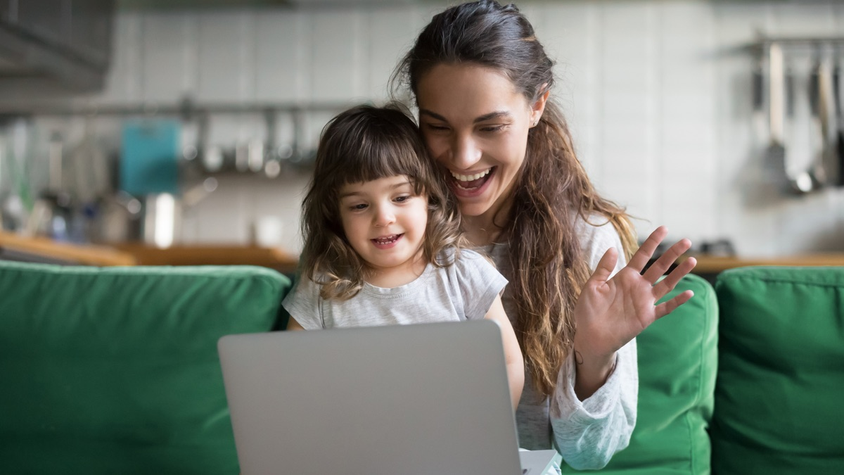 woman and child on video call at home