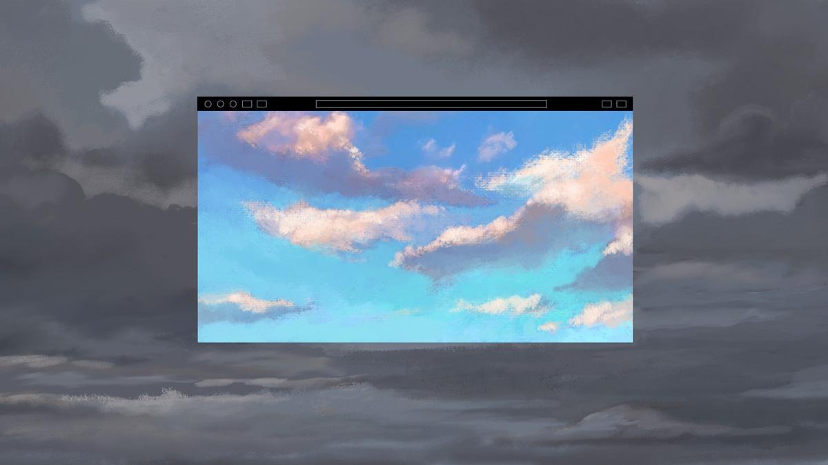 Blue skies on a computer screen breaking through grey skies.
