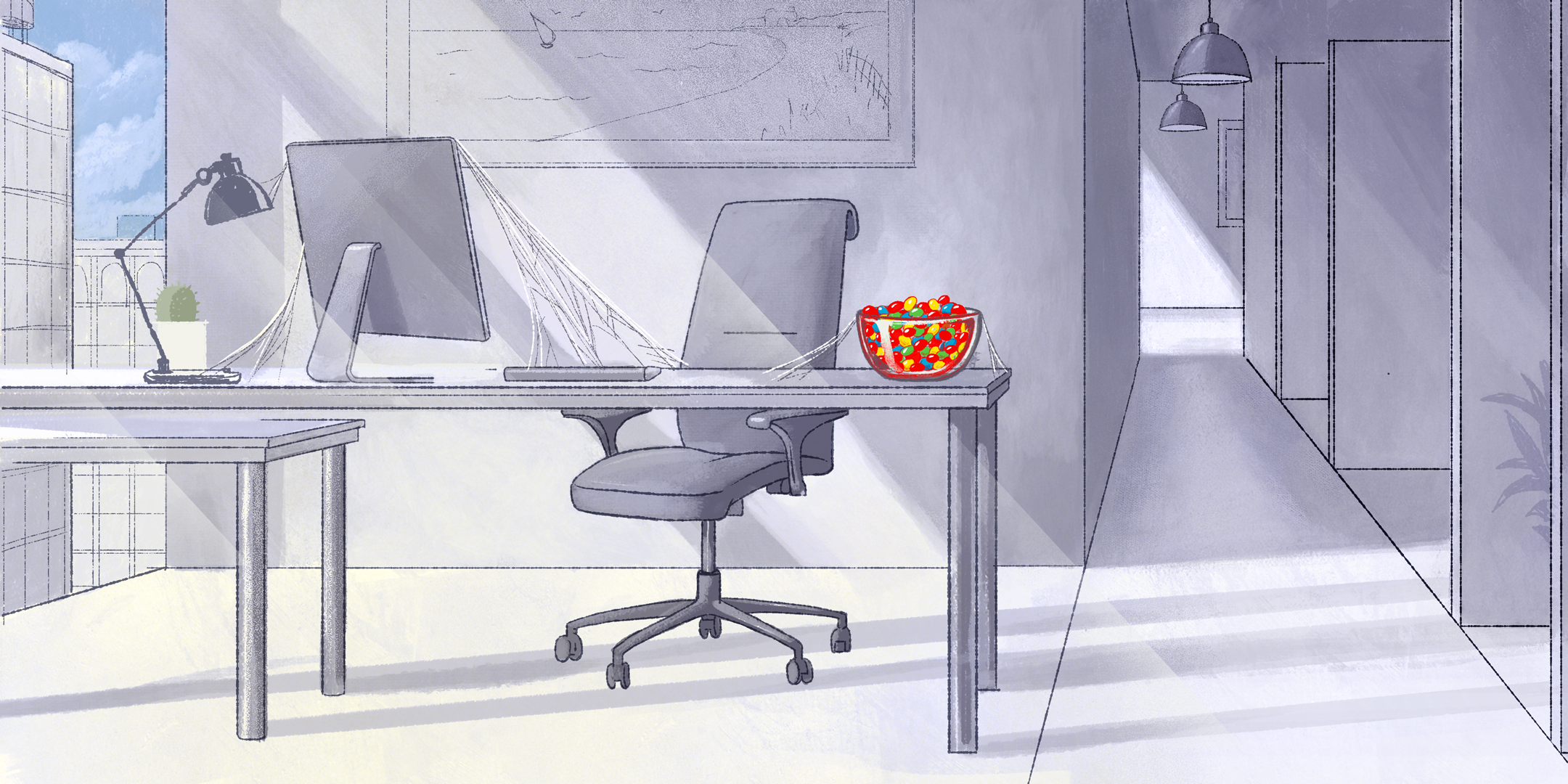 Empty office setting in monochrome grey with a bright, colorful bowl of candy spotlighted on top of a desk.