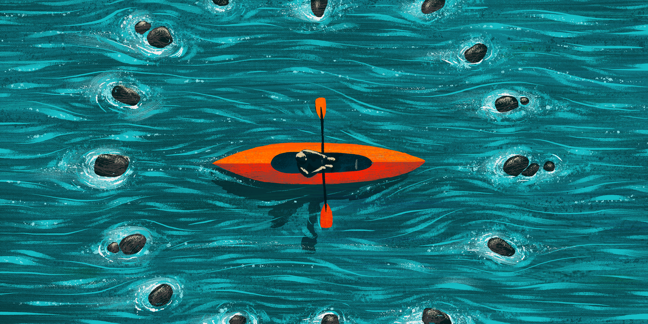 A person in a kayak surrounded by rocks